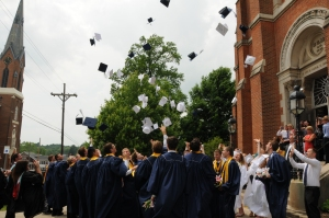Graduates toss their caps in the air!