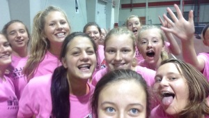 A group of the OA Volleyball team, twister sisters, pose for a selfie at Ball State Team Camp