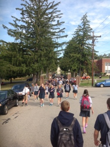 Students walk back and forth on campus.